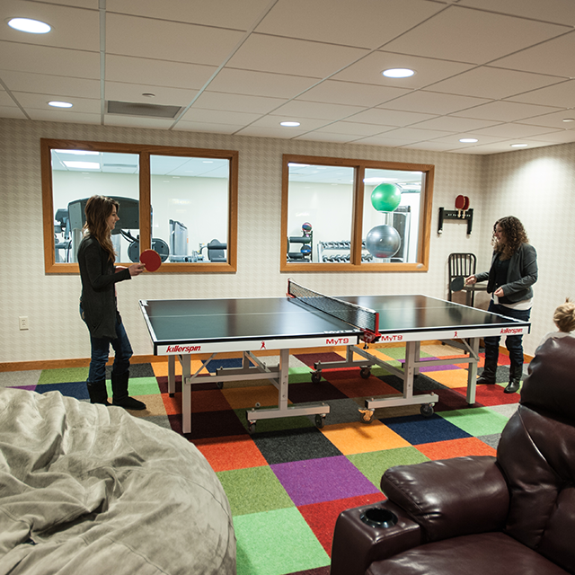 Girls playing Ping Pong in the Game Room